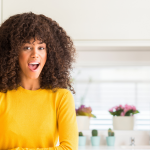 Woman smiling in her kitchen