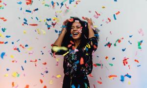 Happy woman with confetti